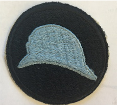 """The """"blue hat"""" Casque Adrian helmets worn by the 93rd Division became that unit's symbol."""