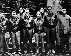 Col. Doolittle (frontmost) and his co-pilot Richard Cole with members of their flight crew and Chinese officials in China after the April 18, 1942 Tokyo raid. Richard Cole is to Doolittle's right.